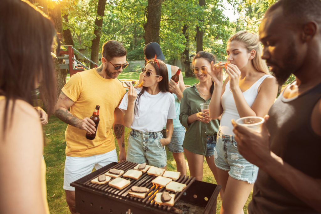 32860597-happy-friends-are-having-beer-and-barbecue-party-at